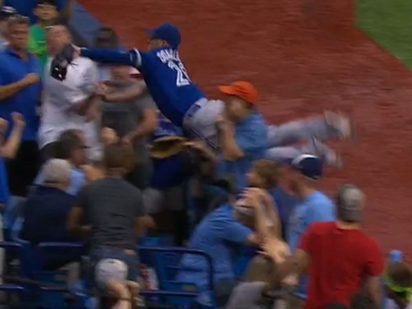 Baseballer dives into crowd for stunning catch
