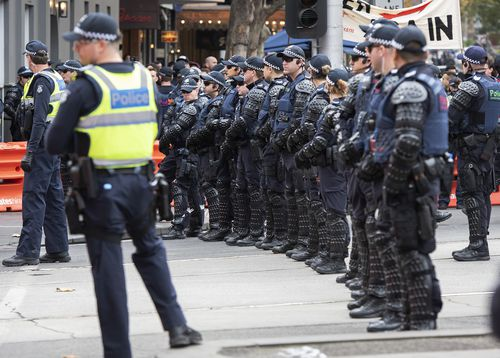 Some officers wore riot gear to the march. (AAP)
