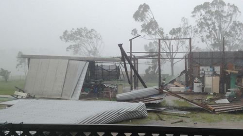 Pieces of the shed lay strewn across a Yeppoon backyard. (Supplied: Natalee Smith)