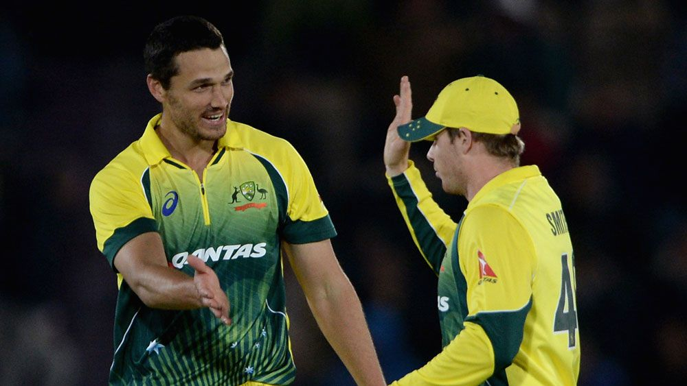 Nathan Coulter-Nile celebrates a wicket with Steve Smith. (Getty)