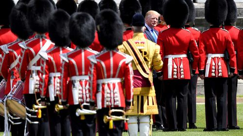 Donald Trump inspects the Queen's guard.