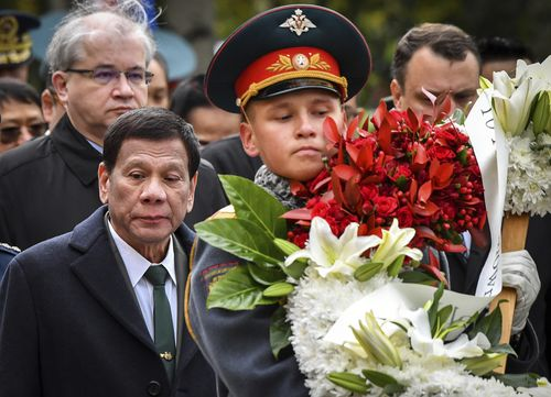 Philippine President Rodrigo Duterte attends a wreath laying ceremony at the Tomb of the Unknown Soldier in Moscow, Russia, Friday, Oct. 4, 2019. (Yury Kadobnov/Pool Photo via AP)
