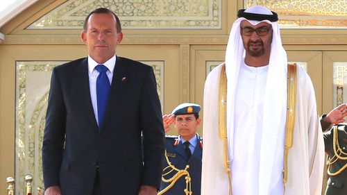 Prime Minister Tony Abbott is welcomed by the Crown Prince of Abu Dhabi at the Al Mushrif Palace in Dubai. (AAP)