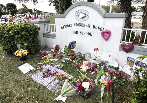 Tributes for the victims outside the Parkland, Florida high school. (EPA/AAP)