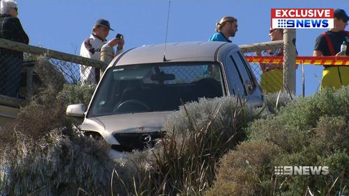 Witnesses said the car became wedged on the edge of a small cliff, bringing it to a stop. Picture: 9NEWS