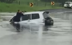 Two women escape car sinking in floodwaters