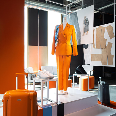 SkyUp Airlines new female cabin crew uniform featuring a pants suit and sneakers by Ukrainian designer Gudu