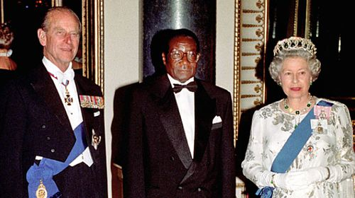 Robert Mugabe with the Queen and Prince Philip during a state visit to Britain in the 1990s. (Photo: PA).