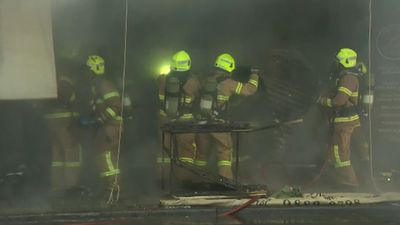 Bags left near fridge spark Melbourne shop blaze