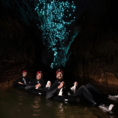 Float through caves lit by glow worms