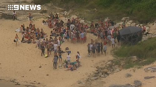 Two police officers were injured as they tried to disperse the crowd. (9NEWS)