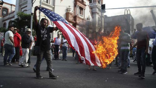 An American flag is burned during a protest in San Pedro Sula, Honduras.