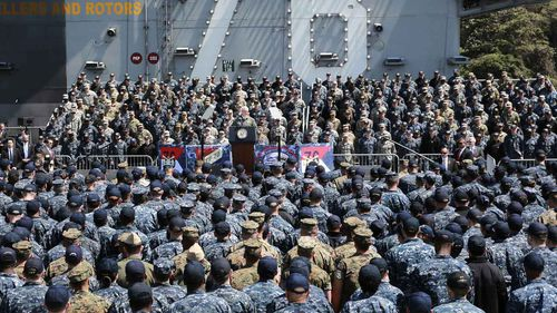 Mike Pence speaks to Japanese and US servicemen aboard the USS Ronald Reagan in Japan. (AAP)