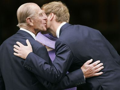 Prince Philip kisses grandson Prince William.