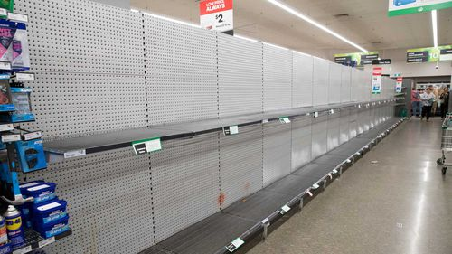 Empty toilet paper shelves in Woolworths, Wetherill Park, Sydney.