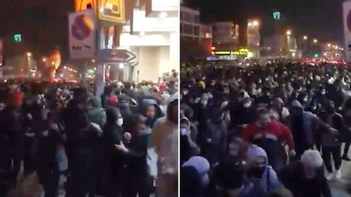 These images made from a Sunday, January 12, 2020, video provided by the New York-based Center for Human Rights in Iran, shows police firing tear gas into a crowd in Tehran.