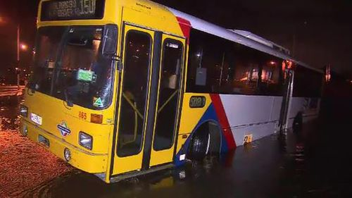 A bus became stuck due to flooding in Adelaide. (9NEWS)