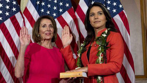 Tulsi Gabbard (right) is sworn into Congress by Speaker Nancy Pelosi.