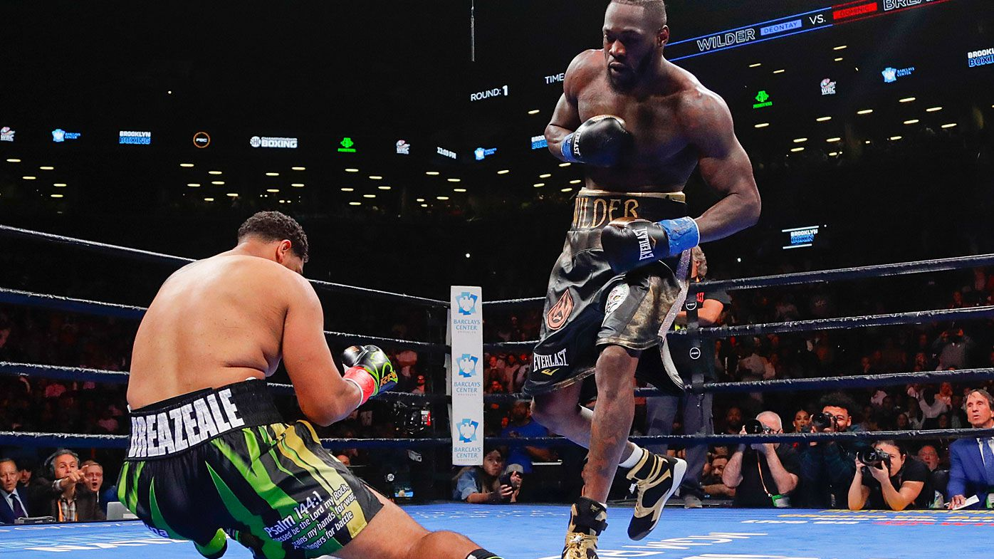 Deontay Wilder, right, knocks down Dominic Breazeale