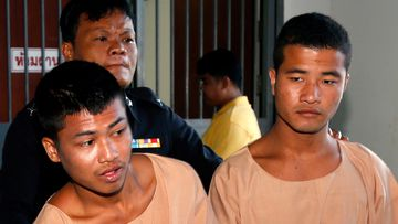 Myanmar migrant workers, who are accused of the killing of two British tourists, Zaw Lin (R) and Wai Phyo (L) are escorted by a Thai police officer after they were sentenced to death