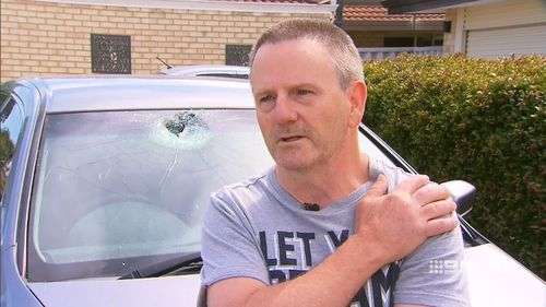 Bill Wells was left with glass shards in his eye and a sprained shoulder after rocks were thrown from Mandurah overpass.