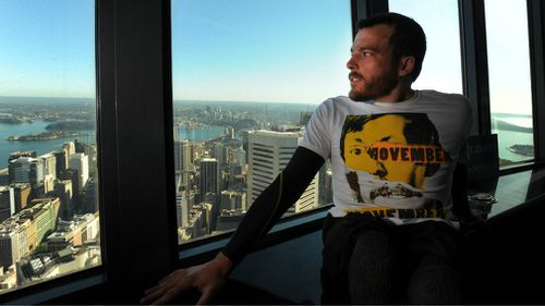 Fearnley takes in the view after crawling up the Sydney Tower Eye. (AAP)