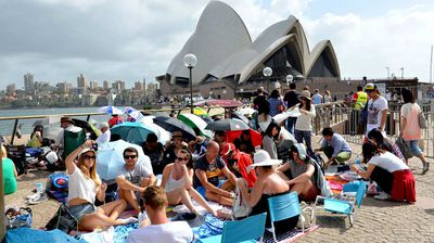 Outside the Sydney Opera House, crowds have filled the area hours in advance. (Getty)