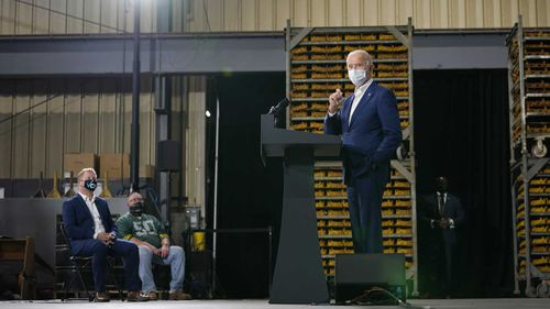 Joe Biden speaks to a socially distanced group at a factory in Wisconsin.