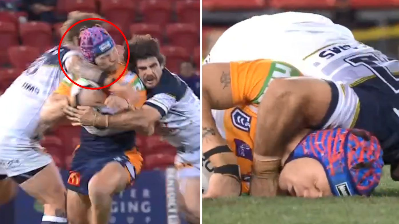 McGuire catches Ponga with 'coat hanger' style tackle. (Nine)