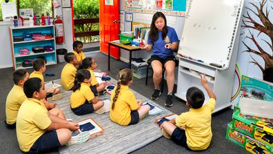 A teacher at a NSW school conducts a lesson in the classroom.