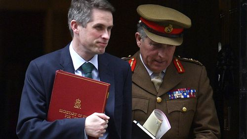 Britain's Defence Secretary Gavin Williamson (L) and Head of the Army General Sir Nick Carter (R) leave after a Cabinet meeting at Downing Street in London.