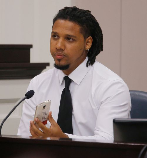 Feiden Santana holding the the cell phone he shot video with showing former North Charleston Police Officer Michael Slager's fatal encounter with Walter Scott (Image: AP)