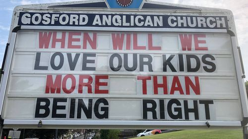 The sign on the roadside by Gosford Anglican Church implored drivers to think about the pill testing debate.