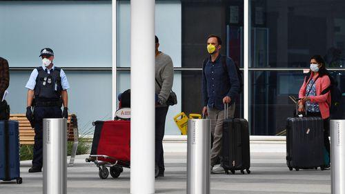 Returning passengers at Adelaide Airport.