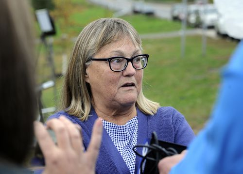 Barbara Douglas, of Danamora, N.Y., talks to reporters about her four family members who died in Saturday's fatal limousine crash in Schoharie