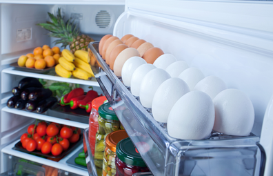 Healthy fridge stocked with vegetables and eggs
