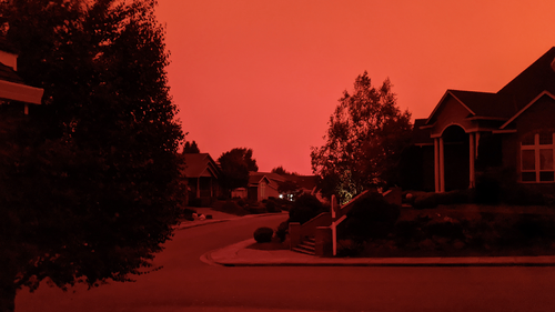 This photo taken from the home of Russ Casler in Salem, Ore., shows smoke-darkened sky around 5 p.m., Tuesday, Sept. 8, 2020, well before sunset.(Russ Casler via AP)