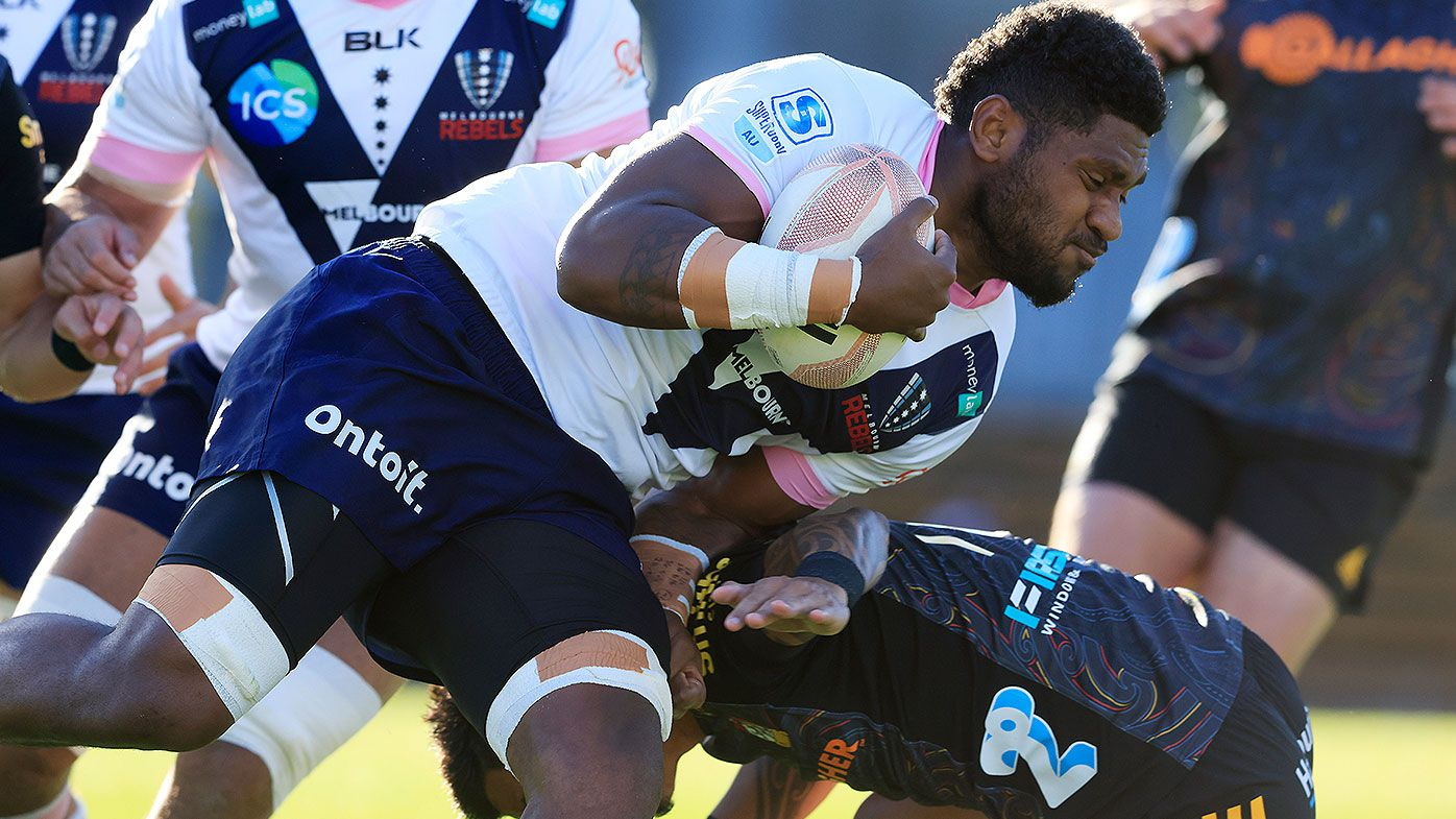 Isi Naisarani of the Rebels is tackled during the round four Super Rugby Trans-Tasman match between the Chiefs and the Melbourne Rebels at Leichhardt Oval on June 06, 2021 in Sydney, Australia. (Photo by Mark Evans/Getty Images)
