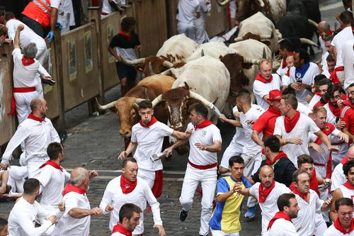 At least three people gored as running of the bulls begins in Pamplona, Spain