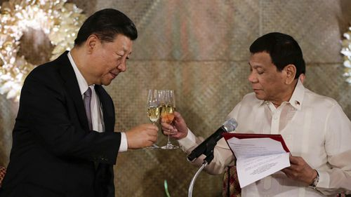 Philippine President Rodrigo Duterte, right, proposes a toast to Chinese President Xi Jinping during a state banquet at Malacanang Palace in Manila, Philippines