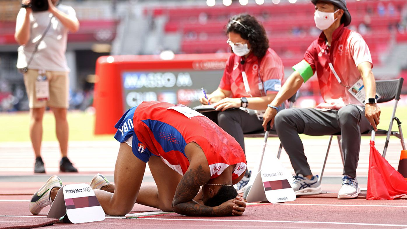 Echevarria collapses in frustration after pulling up with injury.
