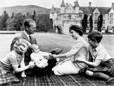 The royal family play with a baby Prince Andrew