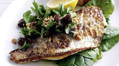 Pan-fried fish with lemon and spinach salad