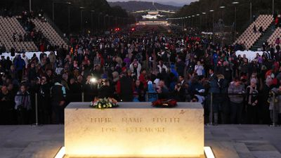 Crowds flock to the Australian War Memorial for the dawn service in Canberra. (AAP)