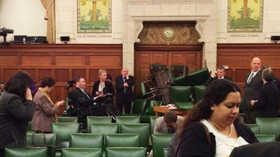 This photo taken by MP Nina Grewal shows MPs barricading themselves in after shots were fired inside parliament. (Picture: Twitter)