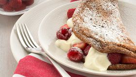 Chocolate  soufflé omelette with berries and yoghurt