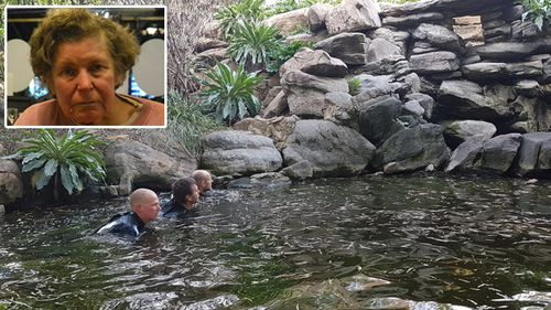 South Australian police drain the pond where Adelaide woman Helen Dansie drowned in April.