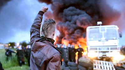 Watched by 80 striking workers, riot police used water cannon to move burning tyres blocking access to a key oil depot in Douchy-les-Mines near the Belgian border that had been in place since Thursday.<br> <br>