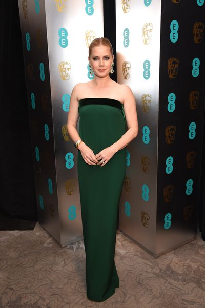 Amy Adams was sleek and elegant in a Tom Ford column dress with a plunging back.