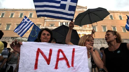 Protesters supporting a 'Yes' to the referendum and demanding Greece to remain in the Eurozone gathered outside the Greek Parliament in Athens, Greece. (AAP)